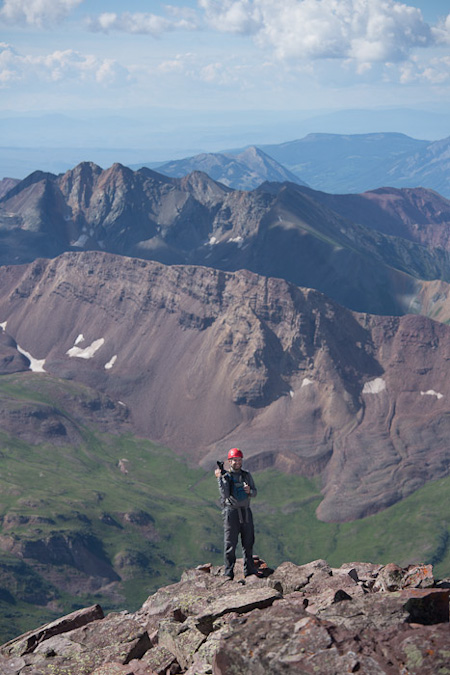 Matt cresting the summit of Maroon Peak