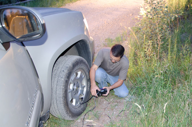 Fixing the flat tire on Rock of Ages road